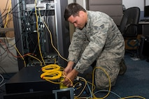 Senior Airman Mathew Gould ensures wires inside of a computer are clean and secure June 26 at Scott Air Force Base, Illinois. Gould is a 375th Communications Support Squadron Information Assurance Technician. (U.S. Air Force Photo by Airman 1st Class Megan Friedl)