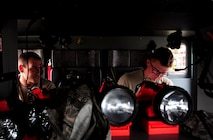 Airman Cody Burns, right, and Airman 1st Class Kaleb Frazier, 509th Civil Engineer Squadron firefighters, inspect a fire truck's engine oil and transmission fluid at Whiteman Air Force Base Mo., May 28, 2015. Firefighters understand the significant impact their job has on the mission and on Whiteman's safety. (U.S. Air Force photo by Senior Airman Keenan Berry/Released)