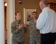 Tech. Sgt. Cheryl Uylaki, Air Force Mortuary Affairs Operations Fisher House NCO in charge, greets David Coker, Fisher House Foundation president June 26, 2015 at the Fisher House for Families of the Fallen, Dover Air Force Base, Del. The house was the 50th Fisher House dedicated and the first of its kind. This was Coker's first visit to the house since the dedication in November 2010. More than 3,000 family members of fallen service members have stayed in the Fisher House.  (U.S. Air Force photo/Senior Airman Stacy Buckley)