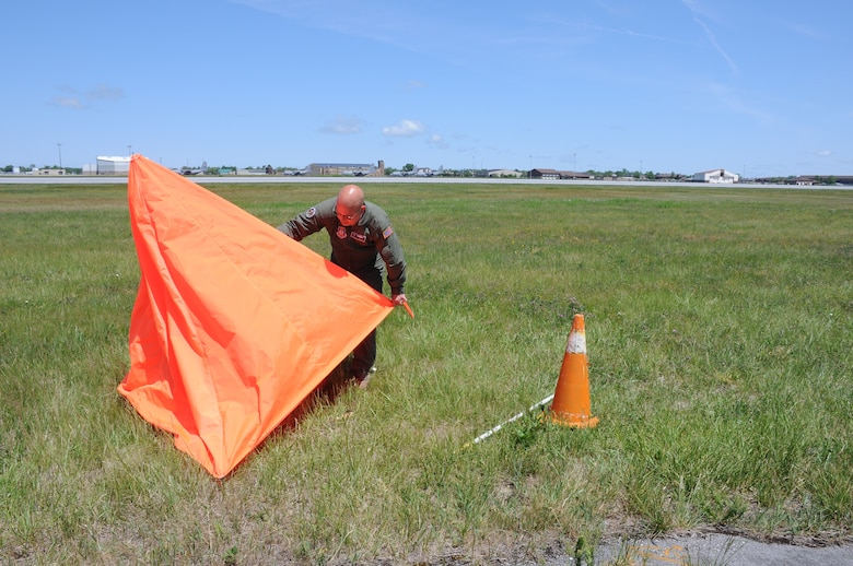 Chief Master Sgt. Michael Zimmerman, Loadmaster Superintendent, 328th Airlift Squadron adjusts a target at Niagara Falls Air Reserve Station on June 3, 2015. Personnel from the 914th Airlift Wing here and the 934th Airlift Wing, Minneapolis-St. Paul Air Reserve Station, Minn., attempted to drop cargo near the target. (U.S. Air Force photo by Staff Sgt. Matthew Burke)