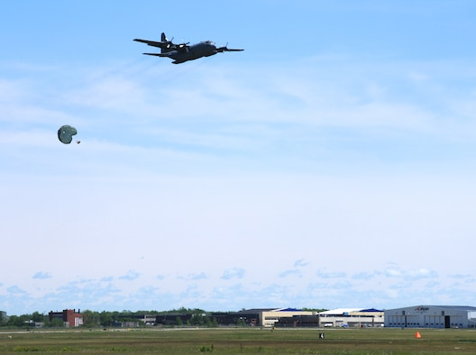 A C-130 Hercules drops cargo at the Niagara Falls Air Reserve Station on June 3, 2014.  Personnel from the 914th Airlift Wing here and the 934th Airlift Wing, Minneapolis-St. Paul Air Reserve Station, Minn. were participating in a multi-unit exercise. (U.S. Air Force photo by Staff Sgt. Matthew Burke)