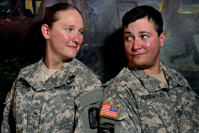 U.S. Army Staff Sgt. Ashely Jacobs, Bravo Company, 2nd Battalion, 210th Aviation Regiment, 128th Aviation Brigade UH-60 Blackhawk Mechanic instructor, left, and Sgt. 1st Class Rachel Underwood, Charlie Co., 1st Battalion, 222nd Avn. Regiment, 128th Avn. Bde. Advanced Individual Training platoon sergeant, married each other five years after the Don't Ask Don't Tell Act was revoked. Both joined before the act was revoked, during which time many lesbian, gay, bisexual and transgendered individuals struggled to keep a part of their lives a secret. (U.S. Air Force photo by Senior Airman Kimberly Nagle/Released)