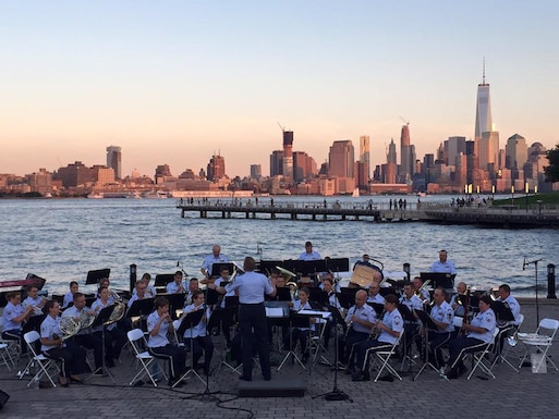 The Air National Guard Band of the Northeast performs on a beautiful night in Hoboken, NJ. The stage in Sinatra Park has the perfect backdrop for the concert with the Freedom Tower standing tall. The concert band and High Altitude performed a concert highlighting the frontiers forged by the Air National Guard for an enthusiastic crowd. (U.S. Air Force Photo/Technical Sgt. Brian McNally)