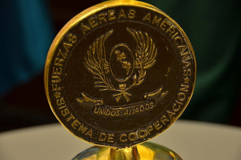 Pictured is the crown of the bell of the System of Cooperation Among the American Air Chiefs, which is rung by the leader of the host nation air force holding the annual Conference of the American Air Chiefs to both open and close the session. In its 55th year, SICOFAA is made up of 20 air forces whose representatives meet regularly to enhance interoperability and make agreements about how the countries will potentially operate jointly, primarily in humanitarian and disaster relief operations. (U.S. Air Force photo by Capt. Bryan Bouchard)