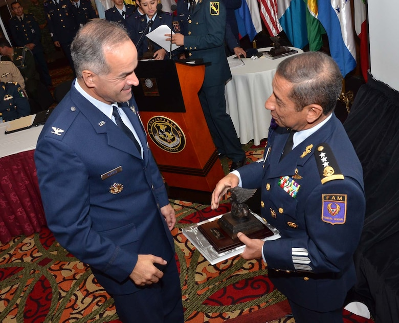 U.S. Air Force Col. Alberto Moreno-Bonet, Secretary General of the System of Cooperation Among the American Air Forces, accepts a gift from Mexico Gen. Carlos Antonio Rodriguez Munguia, Commander of the Mexican air force, during the Conference of American Air Chiefs, June 25 in Mexico City. (U.S. Air Force photo by Capt. Bryan Bouchard)