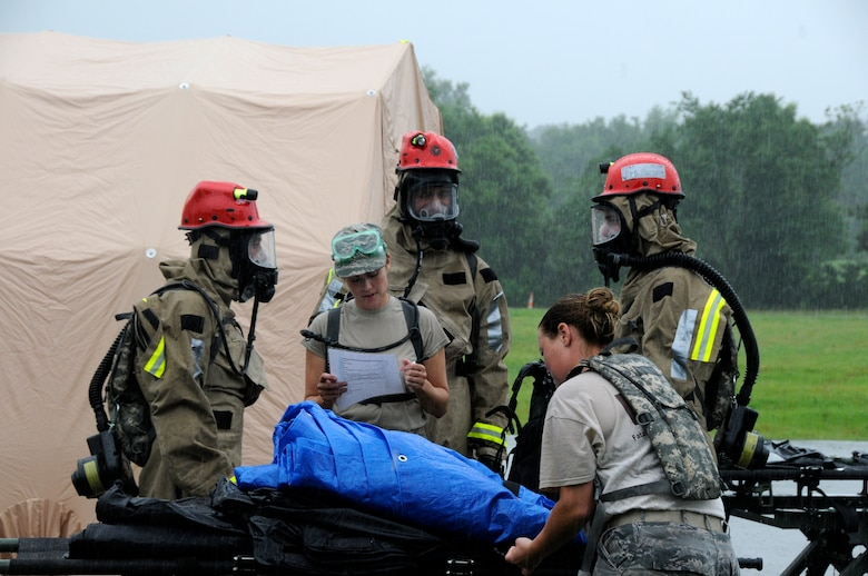 "Members from the 182nd Airlift Wing's Fatality Search and Recovery Team (FSRT) review their checklist as they load a litter carrier with equipment before entering a ""hot zone"" during a CERFP exercise at the Boone County Fire District Training Center near Columbia, Mo., June 17, 2015 (U.S. Air National Guard photo by Tech. Sgt. Todd Pendleton)(Released)"