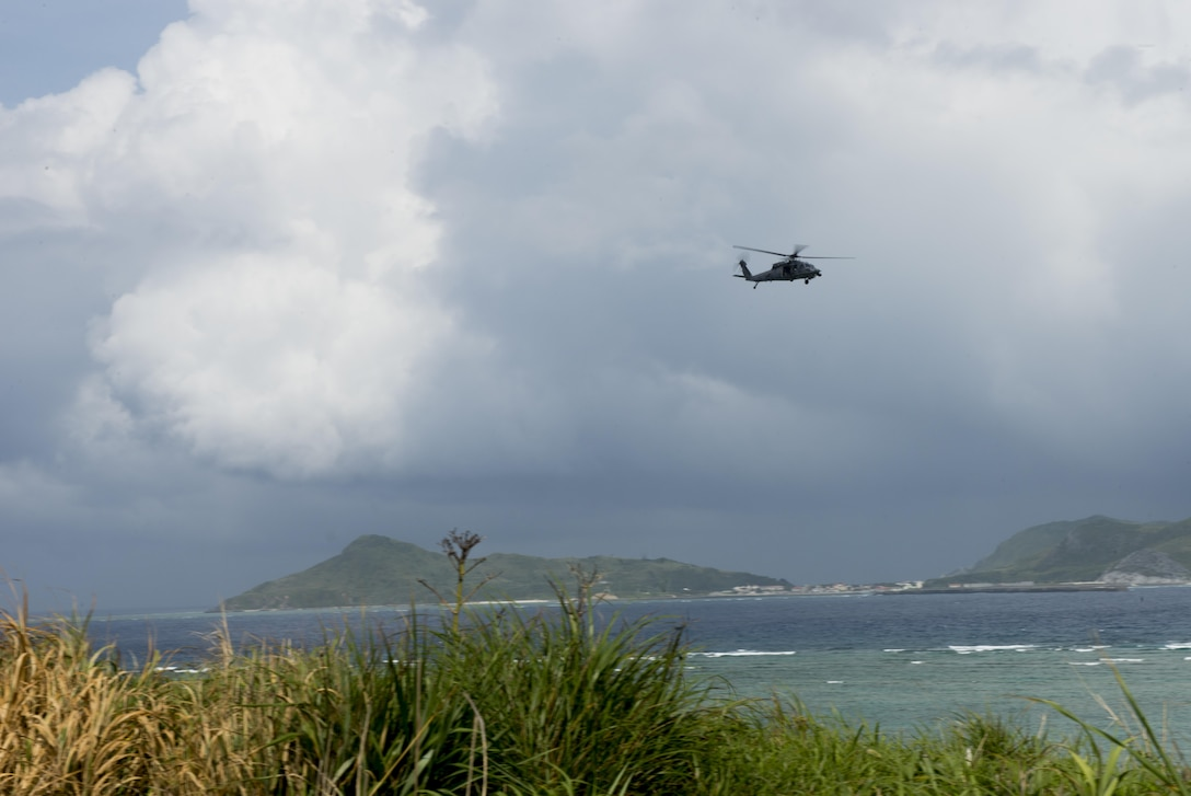 A U.S. Air Force HH-60G Pave Hawk helicopter from the 33rd Rescue Squadron flies off the coast of Okinawa, Japan, during a large force exercise June 30, 2015. The exercise, which integrated U.S. Air Force and Marine Corps assets on Okinawa, was designed to allow the units to practice air-to-air capabilities while supporting ground troops. (U.S. Air Force photo by Staff Sgt. Maeson L. Elleman)