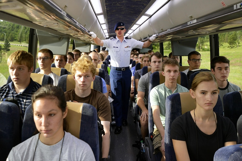 A basic cadet training cadre member provides direction to basic cadets as they leave the U.S. Air Force Academy's Doolittle Hall and head for the cadet area in Colorado Springs, Colo., June 25, 2015. More than 1,000 young adults processed into the Academy and began BCT as members of the Class of 2019. (U.S. Air Force photo/Jason Gutierrez)