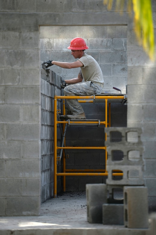 Staff Sgt. Dustin Haycox, an 823rd Expeditionary RED HORSE Squadron structural craftsman from Hurlburt Field, Fla., builds an inner wall of a new two-classroom schoolhouse in the village of Ocotes Alto, Honduras, June 27, 2015. The schoolhouse is part of the New Horizons Honduras 2015 training exercise. The exercise improves joint readiness of U.S. and partner nation civil engineers, medical professionals, and support personnel through humanitarian assistance activities. (U.S. Air Force photo/Capt. David J. Murphy)