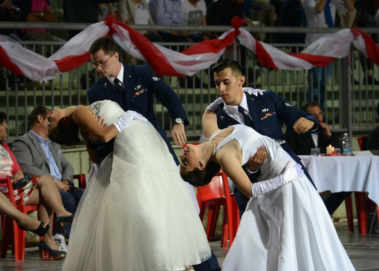 Senior Airman John Hovde, a 31st Logistics Readiness Squadron traffic management journeyman, and his partner, Silvia, perform with Airman 1st Class Evan Nuber, a 31st Munitions Squadron munitions operations technician, and his partner, Alisea, during the 17th annual Debutant Ball June 21, 2015, in Cordenons, Italy. Beginning in March, Airmen practiced two times a week and daily during the two weeks prior to the event. (U.S. Air Force photo/Airman 1st Class Deana Heitzman)