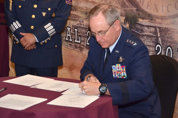 Air Force Chief of Staff Gen. Mark A. Welsh III signs an agreement at the conclusion of the Conference of American Air Chiefs June 25, 2015, in Mexico City. The conference is an annual event sponsored by the System of Cooperation Among American Air Chiefs, which is headquartered at Davis-Monthan Air Force Base, Ariz., and includes representatives from 20 Western Hemisphere air forces. (U.S. Air Force photo/Capt. Bryan Bouchard)