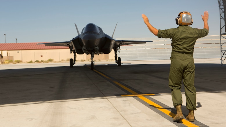 A F-35B Lightning II with Marine Operational and Test Evaluation Squadron 22 taxies under a canopy aboard Edwards Air Force Base, California, Oct. 9, 2014.  This is the squadron's first F-35 Lightning II.
