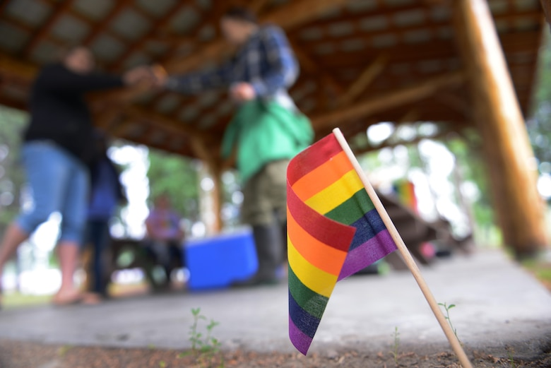 A rainbow flag is placed in the ground for Lesbian, Gay, Bisexual and Transgender Pride Month during the Picnic in the Park at Nussbaumer Park, June 27, 2015, in Fairbanks, Alaska. More than 200 flags were handed out to members of the 354th Fighter Wing and members of the local community. (U.S. Air Force photo by Senior Airman Ashley N. Taylor/Released)