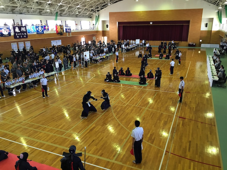 "Japanese Kendo, Ju Kendo and Kempo tournament participants spar during the tournament June 25, 2015, near Iruma Air Base, Japan. The 623rd Air Control Flight ""Lightsword"" combined with their Japan Air Self-Defense Force counterparts during a temporary deployment to Iruma Air Base, Japan, to strengthen bilateral relations June 22 through 26, 2015. (U.S. Air Force courtesy photo by Lt. Col. Daniel Biehl/Released)"