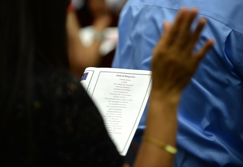 A new U.S. citizen reads the Oath of Allegiance July 2, 2015, in Hagåtña, Guam. Twenty-four applicants received their U.S citizenship during a naturalization ceremony held in conjunction with Independence Day weekend. (U.S. Air Force photo by Senior Airman Alexander W. Riedel/Released)