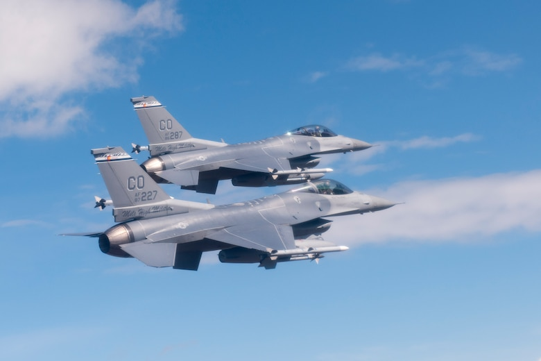 Two F-16 Fighting Falcons from the 120th Fighter Squadron, 140th Wing, Colorado Air National Guard, fly over the Denver-Metro area May 29, 2015. (Air National Guard Photo by Tech. Sgt. Wolfram Stumpf)