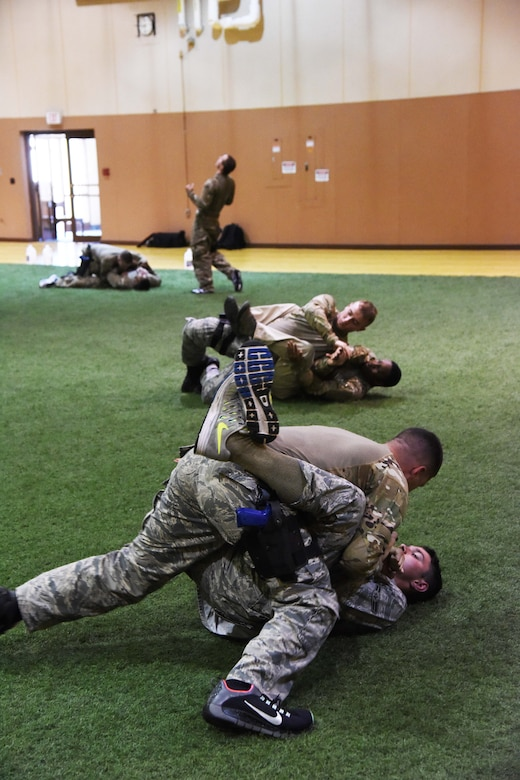 Members of the 341st Security Forces Group at Malmstrom Air Force Base spar during a Combatives Instructor Course at the base's fitness center June 30. The course focuses on weapons retention, suspect control and challenge techniques, and close-quarter hand-to-hand combative technique. (U.S. Air Force photo/Airman 1st Class Collin Schmidt)