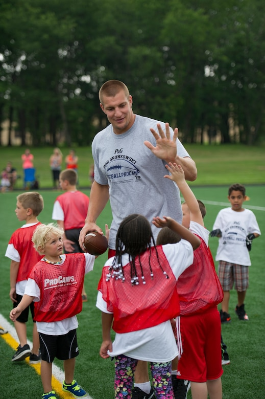 Rob Gronkowski, New England Patriots tight end, high-fives his team during a football camp on Joint Base Andrews, Md., July 2, 2015. Gronkowski, a three time Pro Bowler and Super Bowl XLIX champion, coached approximately 100 military children during the two-day camp. (U.S. Air Force photo/Tech. Sgt. Robert Cloys)