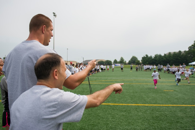 Rob Gronkowski, New England Patriots tight end, clocks sprint times during a race at a ProCamps event on Joint Base Andrews, Md., July 2, 2015. Gronkowski, a three time Pro Bowler and Super Bowl XLIX champion, coached approximately 100 military children during the two-day football camp. (U.S. Air Force photo/Tech. Sgt. Robert Cloys)