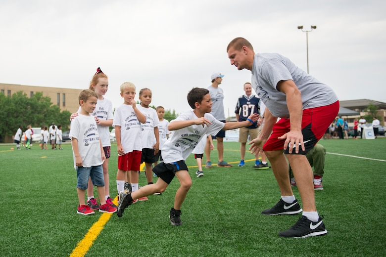 Rob Gronkowski, New England Patriots tight end, runs football drills with participants of a ProCamps event on Joint Base Andrews, Md., July 2, 2015. Gronkowski, a three time Pro Bowler and Super Bowl XLIX champion, coached approximately 100 military children during the two-day football camp. (U.S. Air Force photo/Tech. Sgt. Robert Cloys)