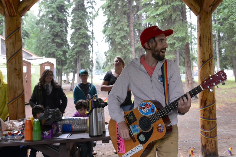 "Nick Meurlott, member of local band Dangerlot, performs an original song, ""Cardboard Streams Forever"" during the Picnic in the Park at Nussbaumer Park, June 27, 2015, in Fairbanks, Alaska. Meurlott performed three songs and handed out free t-shirts to attendees as a way to celebrate love and equality. (U.S. Air Force photo by Senior Airman Ashley Nicole Taylor/Released)"