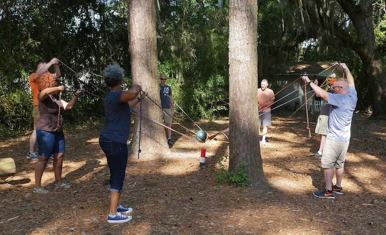 U.S. Airmen with the Georgia Air National Guard, work together during a team building exercise at the outdoor adventure course during the Strong Bonds singles retreat at the Sea Palms Resort, Saint Simons Island, Ga., June 27, 2015. The retreat, hosted by chaplains from the 116th Air Control wing, is a key component of the unit's resiliency program aimed at helping Airmen from Air National Guard units across Georgia to build relationships, learn to trust people, and hone their teambuilding skills. (U.S. Air National Guard photo by Senior Master Sgt. Roger Parsons/Released)