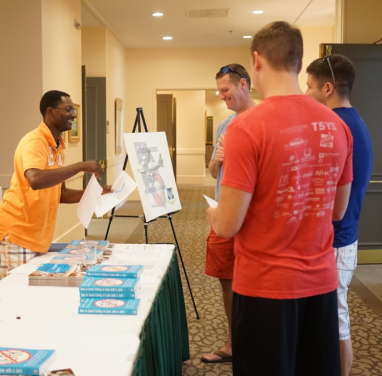 U.S. Air Force Technical Sgt. Steven Battle, 116th Air Control Wing chaplains assistant, Georgia Air National Guard, assists Airmen arriving for the Strong Bonds singles retreat at the Sea Palms Resort, Saint Simons Island, Ga., June 26, 2015. The retreat, hosted by chaplains from the 116th Air Control wing, is a key component of the unit's resiliency program aimed at helping Airmen from Air National Guard units across Georgia to build relationships, learn to trust people, and hone their teambuilding skills. (U.S. Air National Guard photo by Senior Master Sgt. Roger Parsons/Released)