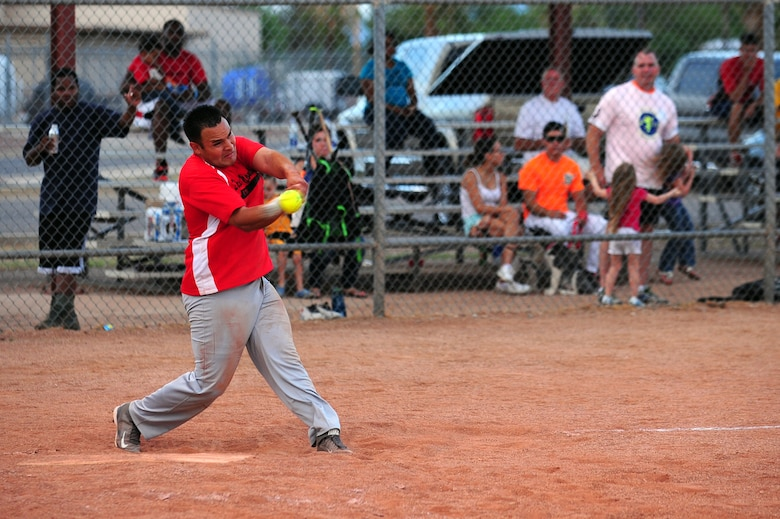 U.S. Air Force Staff Sgt. Cory Gonzales, 355th Civil Engineering Squadron firefighter, gets a base hit during extra innings that lead to the game winning run of the Intramural Softball Championship game at Davis-Monthan Air Force Base Ariz., July 1, 2015. The 355th CES was down six runs in the fourth inning and came back to defeat the 355th Equipment Maintenance Squadron 13-12. (U.S. Air Force photo by Airman 1st Class Chris Drzazgowski/Released)