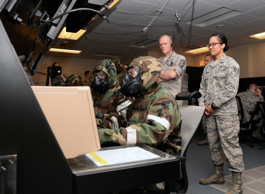 Chief Master Sgt. of the Air Force James Cody, watches air traffic controllers from the 51st Operations Support Squadron demonstrate how they work in simulated chemical environments July 2, 2015, at Osan Air Base, Republic of Korea. Cody was stationed at Osan AB as an air traffic control watch supervisor more than 20 years ago. (U.S. Air Force photo by Staff Sgt. Benjamin Sutton/Released)