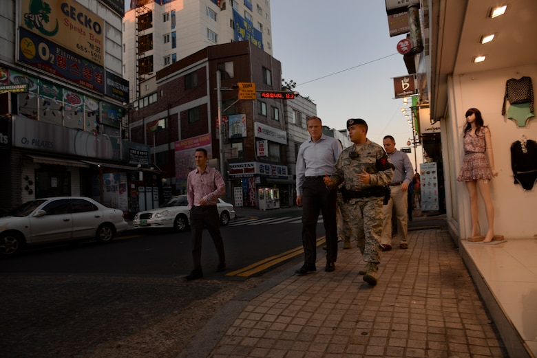 Chief Master Sgt. of the Air Force James Cody, speaks with Tech. Sgt. Markus Mindoro, 51st Security Forces Squadron noncommissioned officer in charge of town patrol, while touring the Songtan Entertainment District July 1, 2015, outside Osan Air Base, Republic of Korea. As the Air Force's highest ranking enlisted Airman, Cody spoke members of town patrol who monitor the streets of the SED during the hours of darkness to ensure the safety of service members and the local community. (U.S. Air Force photo by Staff Sgt. Benjamin Sutton/Released)