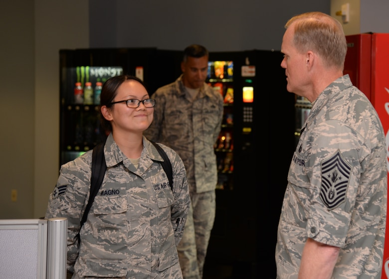 Chief Master Sgt. of the Air Force James Cody, speaks with Senior Airman Anna Pauline Magno, 51st Dental Squadron dental assistant, inside the Air Mobiility Command terminal, July 1, 2015, at Osan Air Base, Republic of Korea. Magno was at the terminal preparing documents for an incoming member when Cody walked by and decided to have a quick chat. (U.S. Air Force photo by Staff Sgt. Benjamin Sutton/Released)