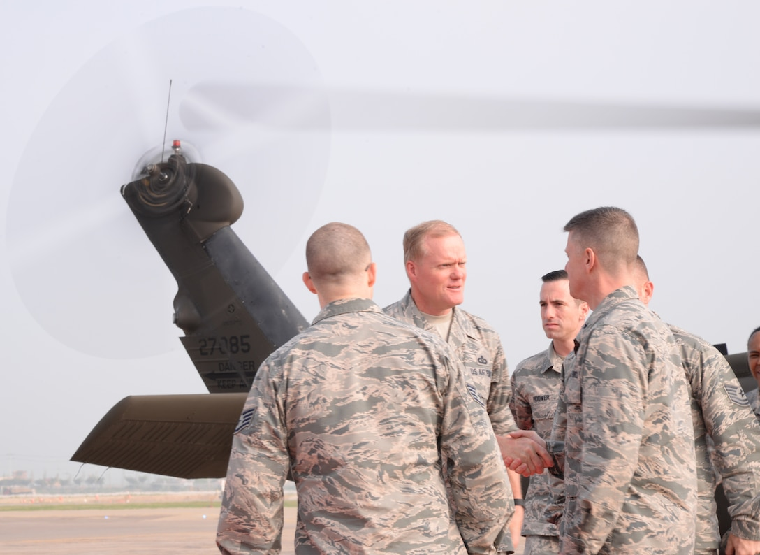 Chief Master Sgt. of the Air Force James Cody, the Air Force's highest ranking enlisted Airman, shakes hands with Brig. Gen. Kyle Robinson, 7th Air Force vice commander, June 30, 2015, at Osan Air Base, Republic of Korea. Cody will spend the next few days personally thanking the Airmen and getting a first-hand look at the fight-tonight readiness essential to the Team Osan mission. (U.S. Air Force photo by Staff Sgt. Benjamin Sutton/Released)