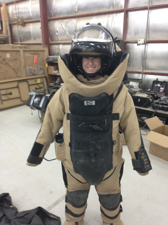 1st Lt Tawny Gardner wears an Explosive Ordinance bomb suit while interacting with the airmen from the 379th Expeditionary Civil Engineering Squadron May 12, 2015 at Al Udeid Air Base, Qatar. Gardner was awarded the 2015 Sexual Assault Prevention and Response innovation award recently by the Department of Defense for her program while deployed to Al Udeid Air Base. (Courtesy Photo)