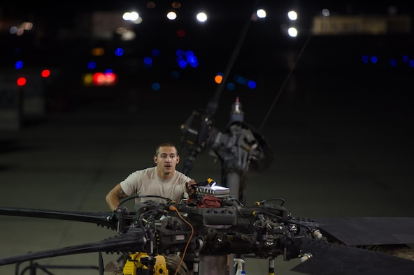 Airman Joshua Herron, a 41st Expeditionary Helicopter Maintenance Unit HH-60 Pave Hawk crew chief, completes a 50-hour inspection on a Pave Hawk at Bagram Airfield, Afghanistan, June 28, 2015. The 41st EHMU ensures Pave Hawks on Bagram Airfield are prepared for flight and returned to a mission-ready state once they land. (U.S. Air Force photo/Tech. Sgt. Joseph Swafford)