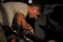 Staff Sgt. Michael Morris, a 41st Expeditionary Helicopter Maintenance Unit HH-60 Pave Hawk crew chief, completes a 50-hour inspection on a Pave Hawk at Bagram Airfield, Afghanistan, June 28, 2015. The 41st EHMU ensures Pave Hawks on Bagram Airfield are prepared for flight and returned to a mission-ready state once they land. (U.S. Air Force photo/Tech. Sgt. Joseph Swafford)