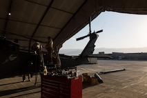 Airmen assigned to the 41st Expeditionary Helicopter Maintenance Unit work to complete a 50-hour inspection on a HH-60 Pave Hawk helicopter at Bagram Airfield, Afghanistan, June 28, 2015. The 41st EHMU ensures Pave Hawks on Bagram Airfield are prepared for flight and returned to a mission-ready state once they land. (U.S. Air Force photo/Tech. Sgt. Joseph Swafford)