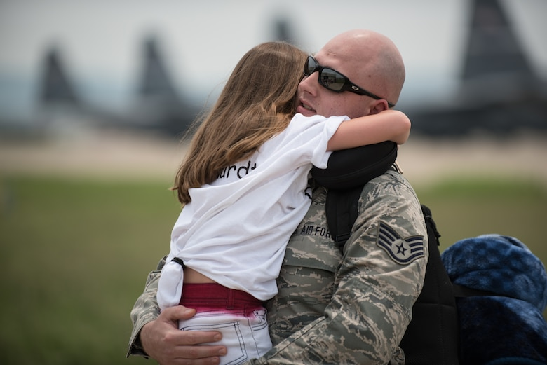 Staff Sgt. Brent Reichardt, an aircraft hydraulics specialist in the 123rd Airlift Wing, hugs his daughter during an emotional homecoming ceremony at the Kentucky Air National Guard Base in Louisville, Ky., July 4, 2015. Reichardt was among 39 Kentucky Air Guardsmen who were returning from a deployment to the Persian Gulf region, where they've been supporting Operation Freedom's Sentinel since February. (U.S. Air National Guard photo by Maj. Dale Greer)