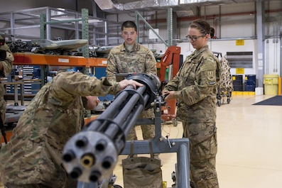 U.S. Airmen assigned to the 455th Expeditionary Maintenance Squadron Armament Flight perform an inspection on an F-16 Fighting Falcon 20mm Gatlin gun at Bagram Airfield, Afghanistan, July 5, 2015. The Gatling gun system is a fixed-forward firing system that provides maximum lethality against air-to-air and air-to-surface targets. (U.S. Air Force photo by Tech. Sgt. Joseph Swafford/Released)