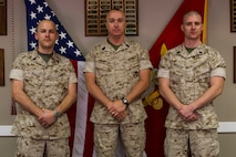 Sergeant Major David Compton (center), sergeant major of Recruiting Station Portsmouth, New Hampshire, stands with newly-promoted Gunnery Sgt. Joshua Roadcap (right) and Staff Sgt. Kristopher Barber following their promotion ceremony at the RS headquarters, July 6. The two Marines were meritoriously promoted after winning their respective recruiter meritorious boards. Roadcap is the staff noncommissioned officer-in-charge of Recruiting Substation Brockton, Massachusetts, and Barber is the SNCOIC of RSS Concord, New Hampshire.