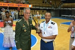 CISM Basketball President Col. Marcio Potengy (Brazil) presents the third place trophy to U.S. Armed Forces Coach Army Lt. Col. William Johnson of Fort Sill, Okla.  USA defeats France 78-41 during the 1st Conseil International du Sport Militaire (CISM) World Women's Basketball Championship in Angers, France June 28 to July 5.
