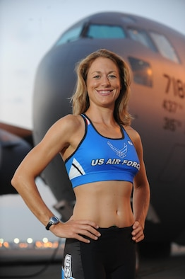 Maj. Jamie Turner stands in front of a C-17 at Joint Base Charleston, S.C. and continued her world-class triathlete success as the second female to cross the finish line at the Armed Forces Triathlon Championship in Hammond, Indiana, June 7, 2015. Turner's second place finish automatically qualified her as one of six athletes to compete on the women's team at the Military World Games in Mungyeong, South Korea, Oct. 2-11, 2015. Turner is a C-17 pilot with the 317th Airlift Squadron. (U.S. Force Photo by James Bowman)