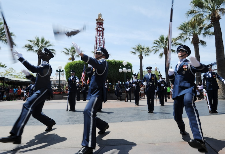 The United States Air Force Honor Guard performs at Disneyland in Anaheim, Calif., July 2, 2015. During the Fourth of July weekend each year, Disneyland invites military units to the park for special performances, a tradition started by Walt Disney on opening day. (U.S. Air Force photo/Staff Sgt. Nichelle Anderson)