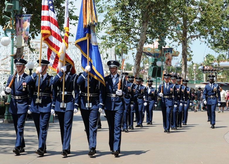 "The United States Air Force Honor Guard participates in a parade at Disneyland in Anaheim, Calif., July 2, 2015. Forty-five guardsmen traveled to Disneyland to participate in the park's ""Celebrate America,"" Fourth of July performances. (U.S. Air Force photo/Staff Sgt. Nichelle Anderson)"
