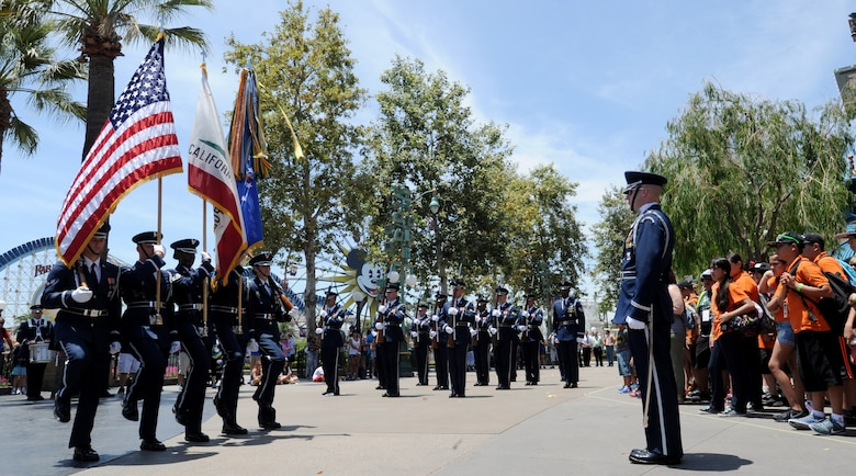 The United States Air Force Honor Guard color guard posts the colors during a drill performance at Disney's California Adventure, July 2, 2015. (U.S. Air Force photo Staff Sgt. Nichelle Anderson)