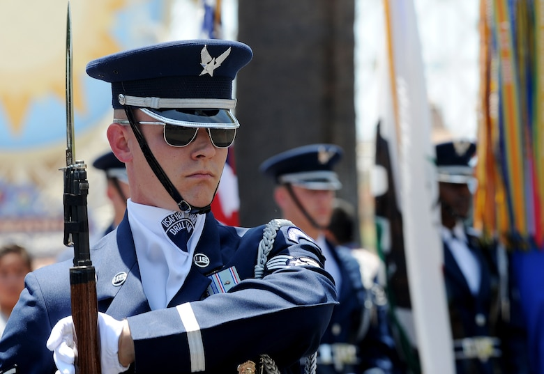 Staff Sgt. Daniel Sellstrom, United States Air Force Honor Guard drill team, participates in a drill performance at Disney's California Adventure in Anaheim, Calif., July 2, 2015. (U.S. Air Force photo/Staff Sgt. Nichelle Anderson)