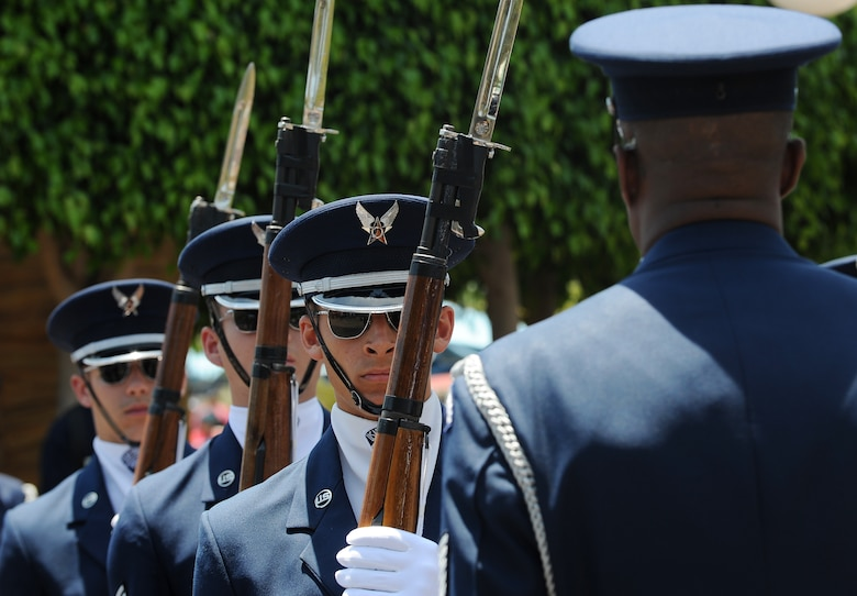 The Unites States Air Force Honor Guard drill team stands in formation during a drill performance at Disney's California Adventure in Anaheim, Calif., July 2, 2015. The HG is scheduled to perform six to seven times daily throughout the Fourth of July weekend. (U.S Air Force photo/Staff Sgt. Nichelle Anderson)