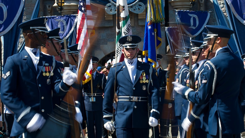 The United States Air Force Honor Guard performs in front of the Disney castle at Disneyland Resort in Anaheim, Calif., July 2, 2015. The Honor Guard is participating in several performances daily throughout the Fourth of July weekend. (U.S. Air Force photo/Staff Sgt. Nichelle Anderson)