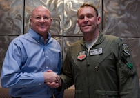 "Retired Col. Tim ""Ghandi"" Healy, left, 34th Weapons Squadron commander from 1999-2001, shakes hands with Lt. Col. Joe ""Krusty"" Alkire, 34th WPS commander, during the 34th WPS' 20th anniversary celebration and reunion at the Desert Oasis Club on Nellis Air Force Base, Nev., June 25, 2015. The purpose of the reunion was to honor the squadron's members who've helped make the unit what it is today, and to bridge the gap between then and now. (U.S. Air Force photo by Airman 1st Class Mikaley Towle)"