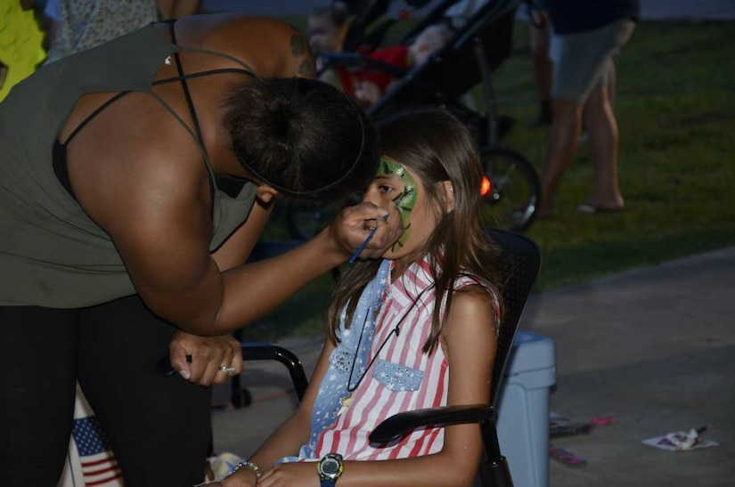 A child gets her face painted during the Joint Base Charleston Freedom Fest celebration June 26, 2015 at Marrington Plantation on JB Charleston - Weapons Station, S.C. More than 1,200 people came out to Marrington Plantation where there was food, games, live music, fireworks and fun for the whole family. Freedom Fest is an annual event at Joint Base Charleston that takes place the last Friday in June at Marrington Plantation. (Courtesy photo / 628th Force Support Squadron)