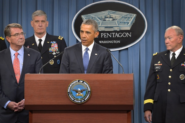 President Barack Obama addresses reporters at the Pentagon, July 6, 2015, after meeting with Defense Secretary Ash Carter, left. Army Gen. Martin E. Dempsey, chairman of the joint Chiefs of Staff, stands at right. DoD photo by Glenn Fawcett